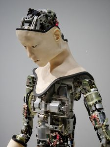 Human-like Robot with its inner mechanical working parts exposed where skin should be covering.
