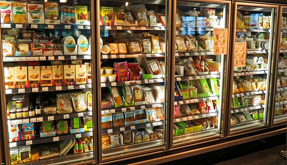 a row of glass doors to a supermarket's refrigerator case.